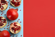 Leinwandbild Motiv Flat lay composition with ripe pomegranates on color background. Space for text