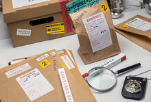 Files And Evidence Bag In A Crime Lab, Conceptual Image