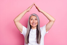 Portrait Of Attractive Cheerful Grey-haired Woman Showing Up Roof Care New Life Change Isolated Over Pink Pastel Color Background