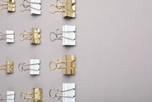 Binder Clips On Grey Background, Flat Lay. Space For Text