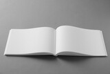 Fototapeta Kawa jest smaczna - Open blank brochure on light grey background