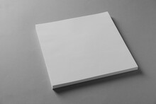 Stack Of Blank Paper Sheets For Brochure On Light Grey Background