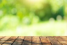 Beautiful Wood Floor And Natural Green Bokeh Background.