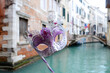 Handmade Face Mask in Venice with background of famous canal,  Venice Italy. - city of love, art and romance