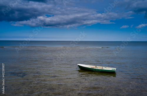 Fotografia, Obraz Small fishing boat floating on the water