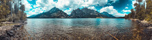 Reflection Of Mountains In The Lake Water On A Cloudy Day - Shot At Lake Jenny At The Foot Of The Grand Teton Mountain Range In Jackson Hole, Wyoming.
