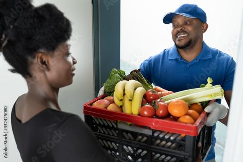 Fototapeta Online Order Food Delivery. African Man obraz