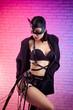 Leinwandbild Motiv sexy woman in leather cat mask on leather straps and bdsm belts