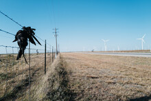 Oil Derricks And Windfarms Share The Soil In West Texas