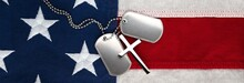 US Military Soldier's Dog Tags, Rough And Worn With Blank Space For Text, And Christian Cross Necklace On American Flag. Memorial Day Or Veterans Day Concept.