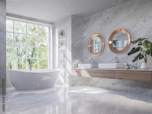 Fototapeta Luxury style light gray bathroom 3d render,There are marble floor and wall ,wooden sink counter and copper frame mirror,Rooms have large windows, overlook nature view,sunlight shining into the room. obraz