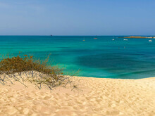 Sunny Day On A Beach In Cape Verde. Atlantic Ocean View From A Sand Dune. Tropical Climate On Boa Vista Island. Selective Focus On The Horizon, Blurred Background.