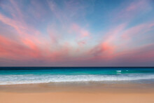 California Beach At Sunset. Pink Clouds And Blue Sea. Sunset At Tropical Beach In Los Angeles, California.