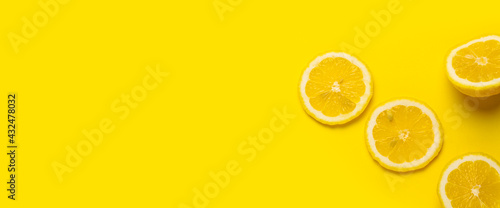 Photo slice of yellow lemon on a yellow background