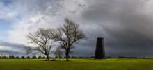 Black Mill With Leafless Treesat Dawn In Spring Beverley, UK.