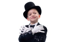 Magician Kid Illusionist Boy In Hat. Childhood Isolated White Background