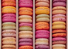 Top View Of Colorful Macarons In Rows In Box