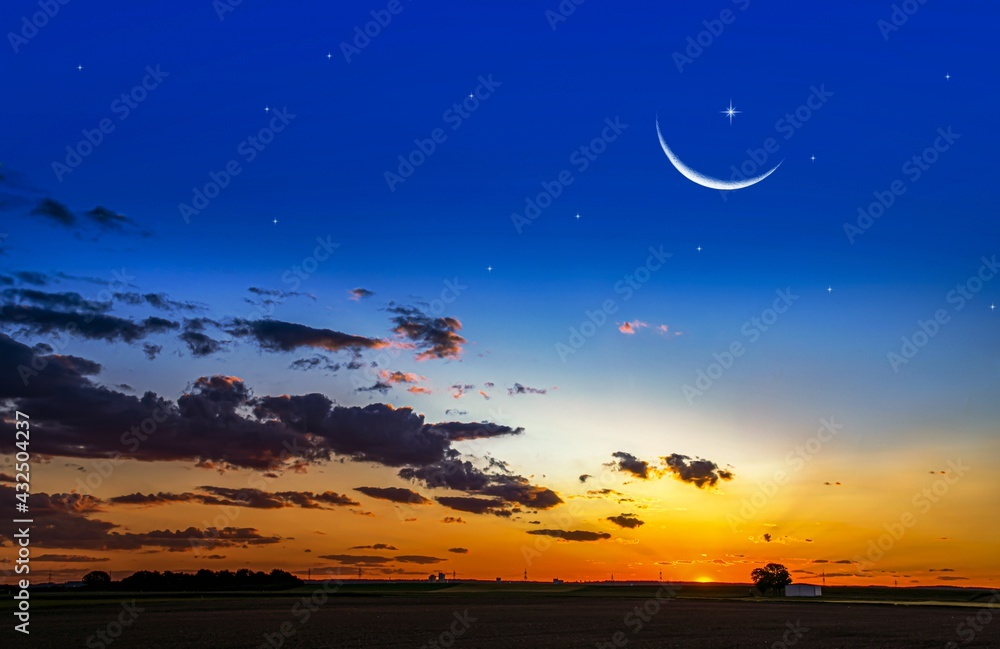 Crescent moon with beautiful sunset background . bright sky . sunset in hot summers, nature background