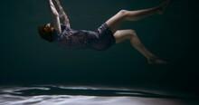 FALLING ASLEEP. Incredible View Of Young Beautiful Woman In Pyjamas, Sleep Mask Sinking Under Water Dreaming Slow Motion