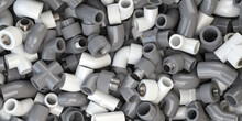 Various Fittings Of Pvc Plastic Pipes And Tubes In Heap. Plumbing Ackground.