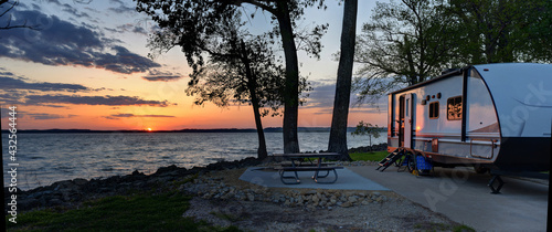Tablou Canvas Travel trailer camping at sunset by the Mississippi river in Illinois at sunset