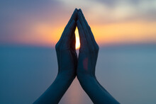 Women's Hands In The Blue Purple Sunset As A Symbol Of Yoga Or Religion, Namaste Silhouette