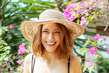 Woman Wearing Straw Hat In The Sun Smiling