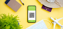 (Flat Lay) A Smartphone With The Digital Green Pass Is Arranged On A Yellow Background.