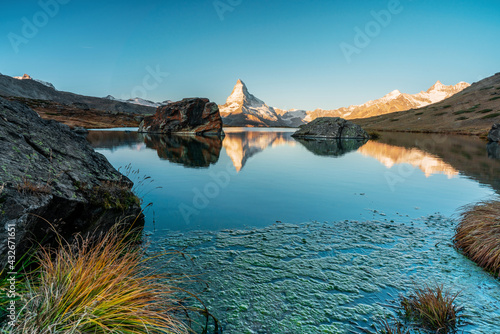 Panoramic morning view of Lake Stellisee with the Matterhorn Cervino Peak in the background. Impressive autumn scene of the Swiss Alps, Zermatt Resort, Switzerland, Europe. #432671651