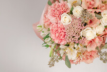 Bouquet Of  Soft Pink Flowers In Pink Wrapping Paper.
