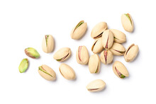 Flat Lay Of Pistachio Nuts On A White Background.