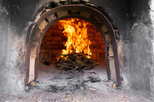 Fire Inside A Brick Furnace Burning To Heat The Oven For The Preparation Of A Lamb