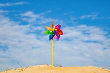Children's Wind Propeller Spinner On The Background Of The Sky