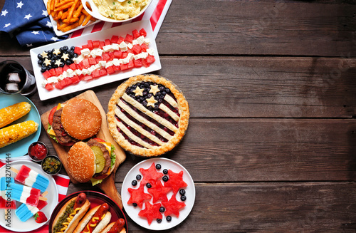 Fototapeta Fourth of July, patriotic, American themed food. Top view side border on a dark wood background. Copy space. obraz