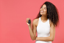Young Fun Dreamful Pensive Thoughtful Smiling Happy African American Woman 20s In Casual White Tank Shirt Holding Car Key Fob Keyless Stystem Look Aside Isolated On Pink Background Studio Portrait