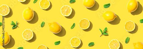 Fototapeta Fresh yellow lemons with mints overhead view obraz
