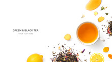 Creative Layout Made Of Cup Of Black Tea, Curcuma, Honey And Lemon On A White Background. Top View.