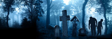 Halloween Scene With Walking Dead's, Medieval Stone Crosses And Tombstone In Cemetery