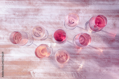 Obraz Rose wine types, shot from above, toned in pink, many glasses of wine - fototapety do salonu