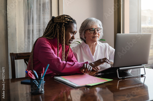 Multiracial senior and young business people with working inside modern office - Focus on african woman face - fototapety na wymiar