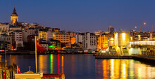 Scenic View Of Lighted Karakoy Quarter And Galata Tower From Golden Horn Bay In Winter Twilight, Istanbul, Turkey
