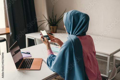 Obraz na plátně modern muslim woman in hijab in office room