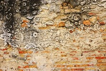 Ancient Masonry Wall With Exposed Bricks, Unusual Limestone Mineral Deposits And Soot Stains