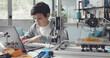 Leinwandbild Motiv Student using a 3D printer at home