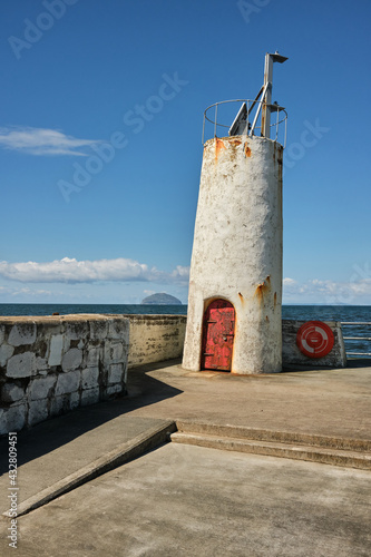 Photo Beacon at Girvan Harbour with a view across to Ailsa Craig.
