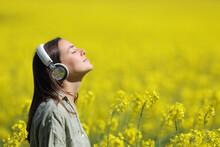 Woman Meditating Listening Audio Guide On Headphones