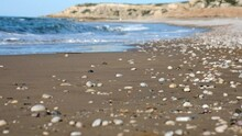 Wide Sand Beach And Rolling Sea Waves With White Thick Foamy Crests Under Blue Cyprus Coast Sky. Calm Waves