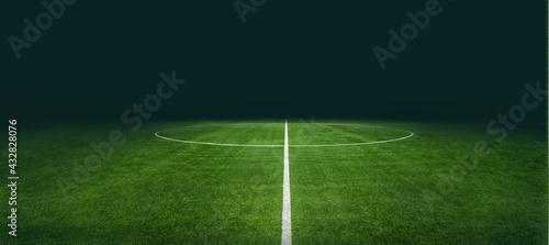Fotografia textured soccer game field with neon fog - center, midfield