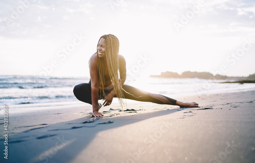 Cheerful fit girl with casual figure stretching legs muscles during morning pila Fototapet