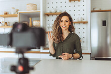 Smiling Young Woman Recording A Video At Home.